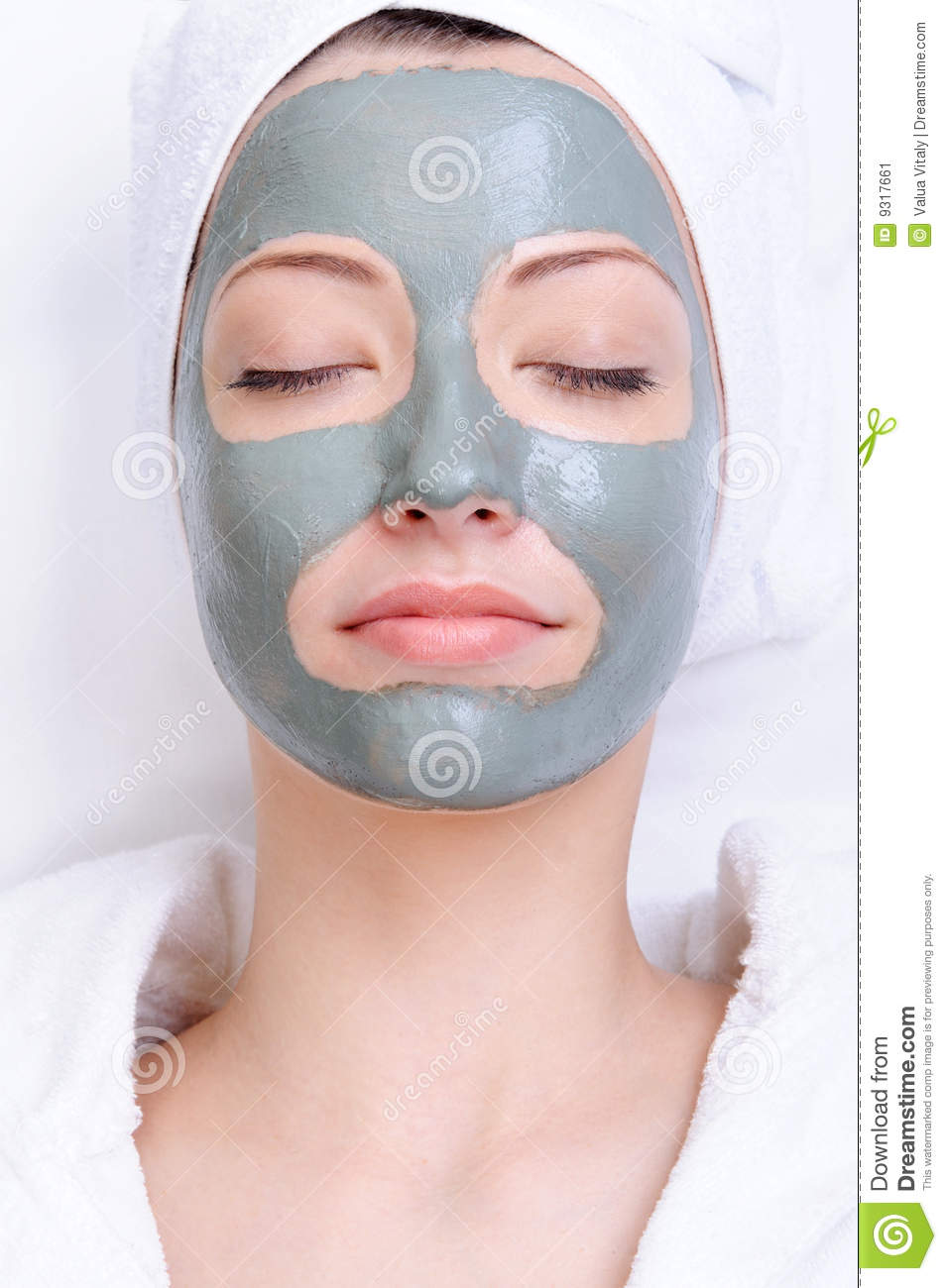 Mask of clay on the young beautiful female