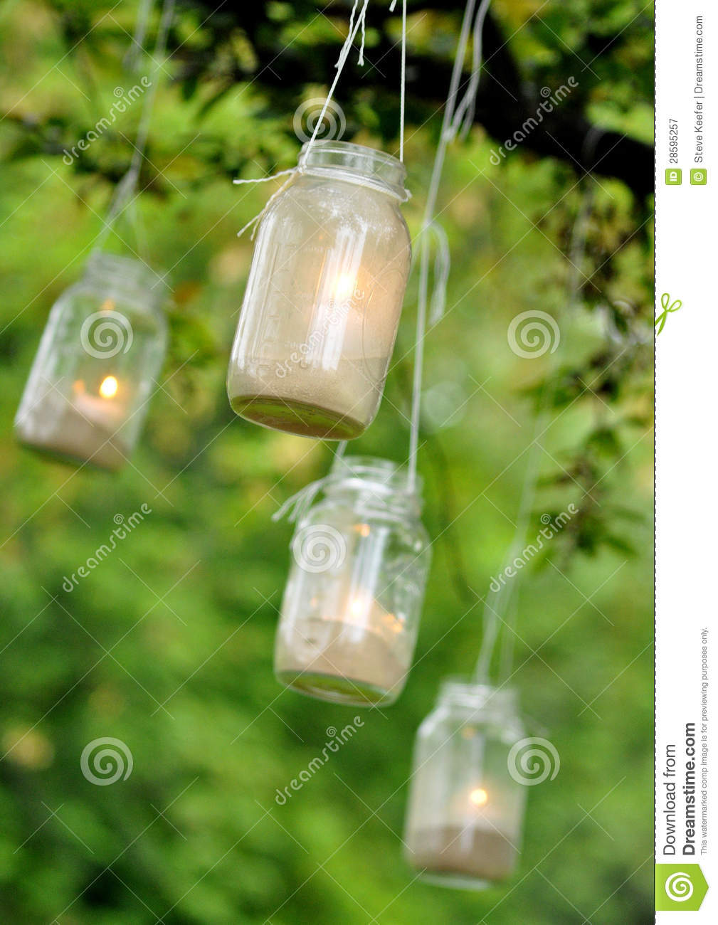 Mason Jar Candles Hanging From A Tree Royalty Free Stock
