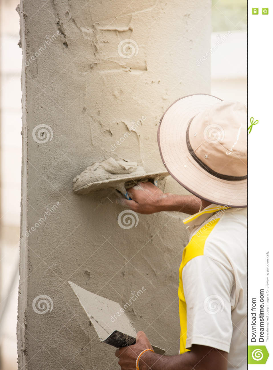 Mason Using Trowel For Plastering The Concrete To Build Wall, Co