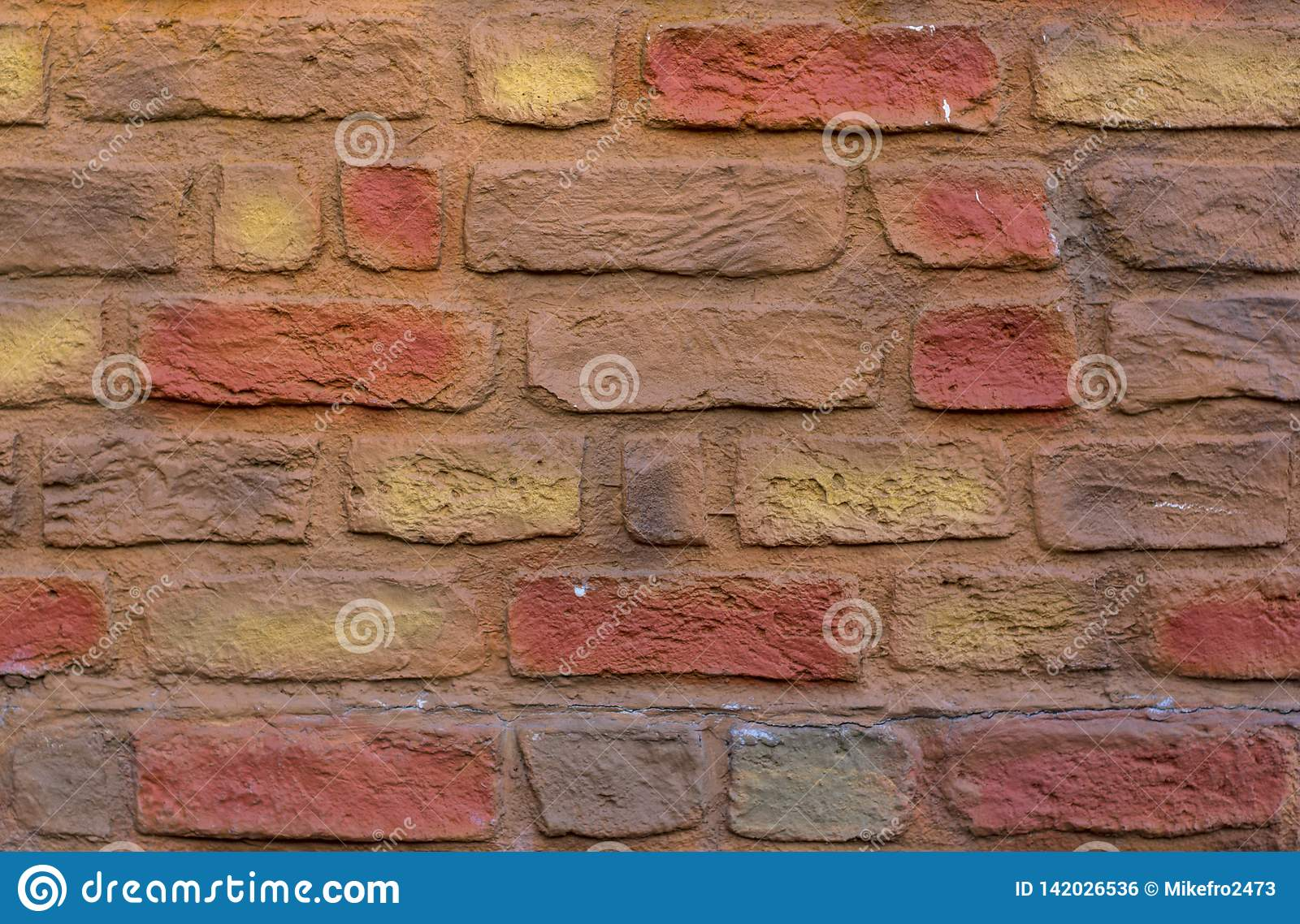 Masonry of colored bricks. Bricks wall texture