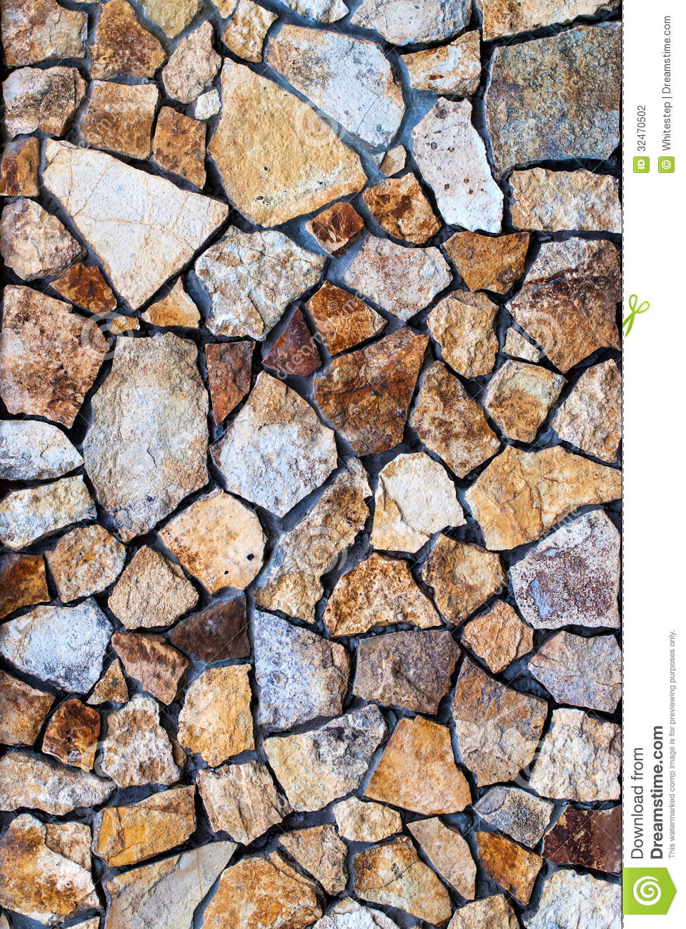 Masonry Wall Of Colors Stones With Irregular Pattern Stock