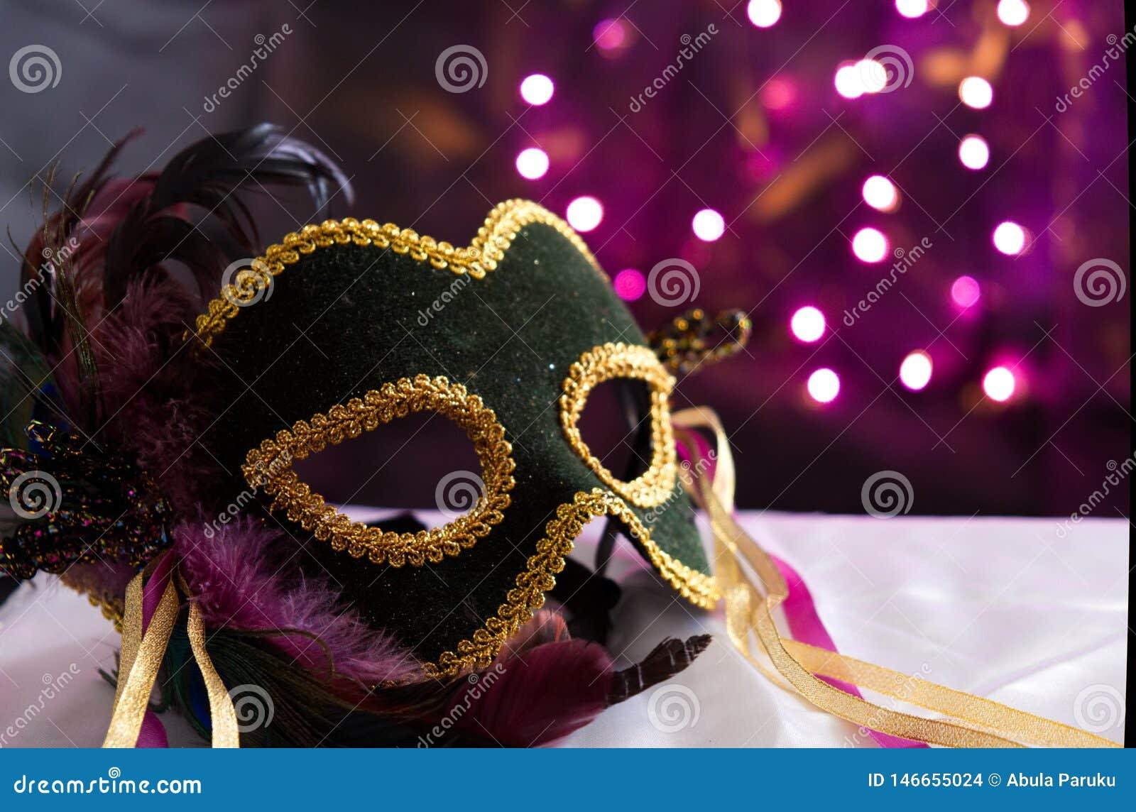 Masque de mascarade avec le fond de Bokeh