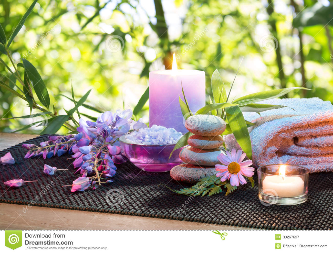 Massage In The Bamboo Garden With Violet Flowers Candles