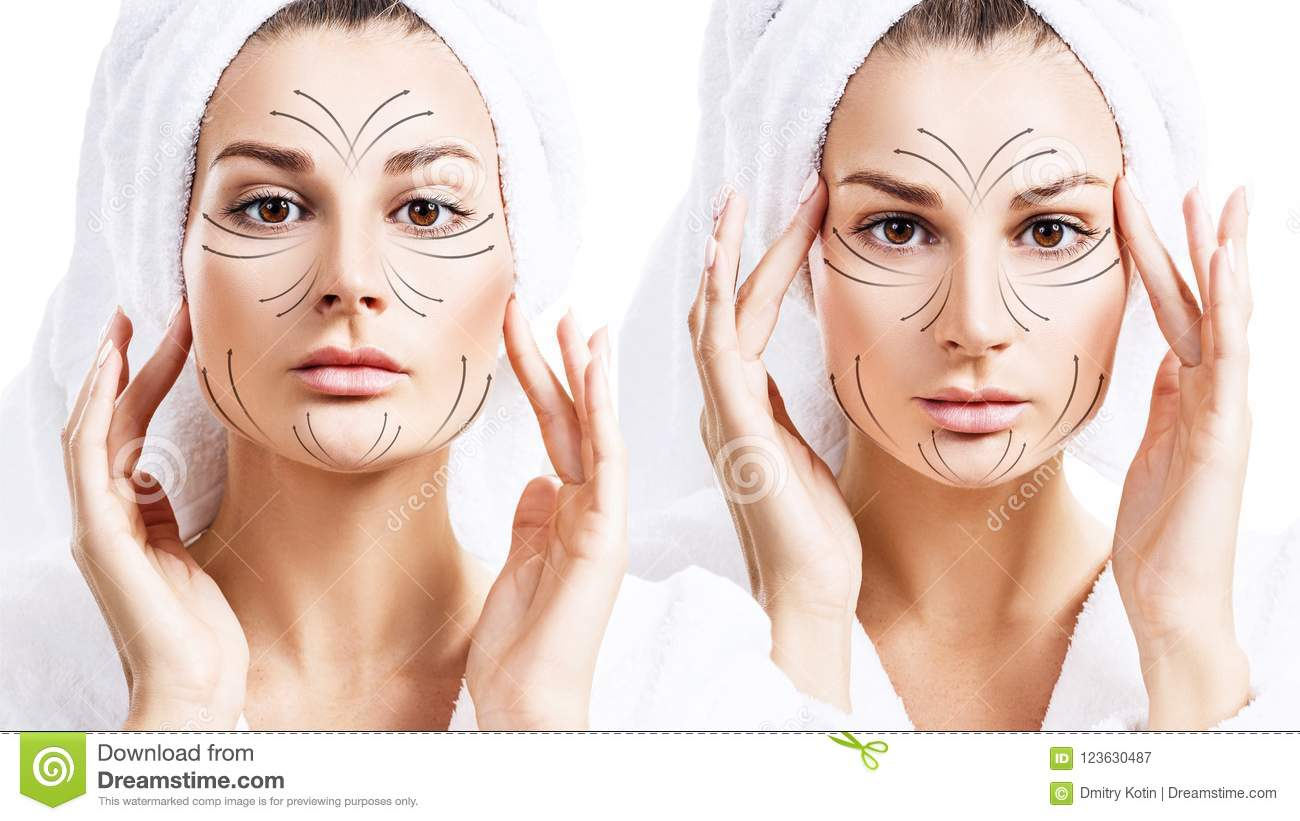 Massage lines on beautiful face of young woman in bathrobe.