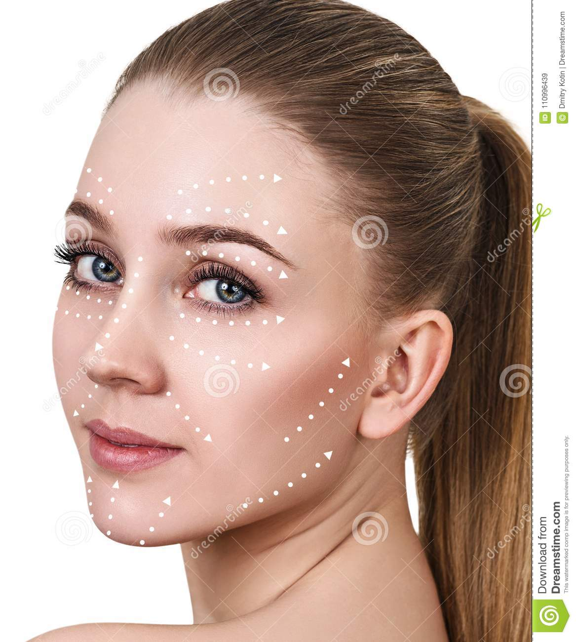 Massage lines on beautiful female face show directions.