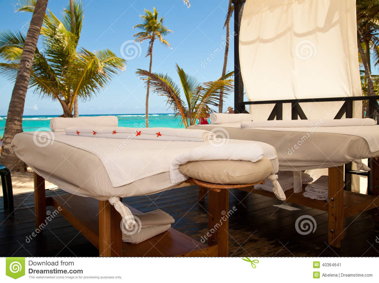 Massage Tables In Tropical Beach Stock Photo