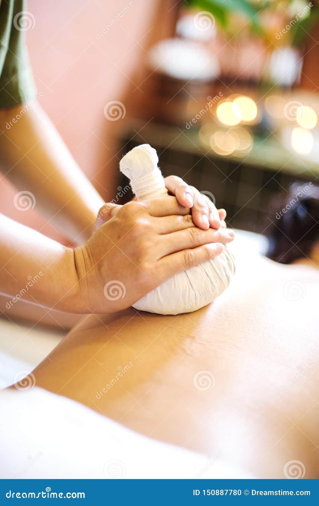 A massage therapist giving a back massage