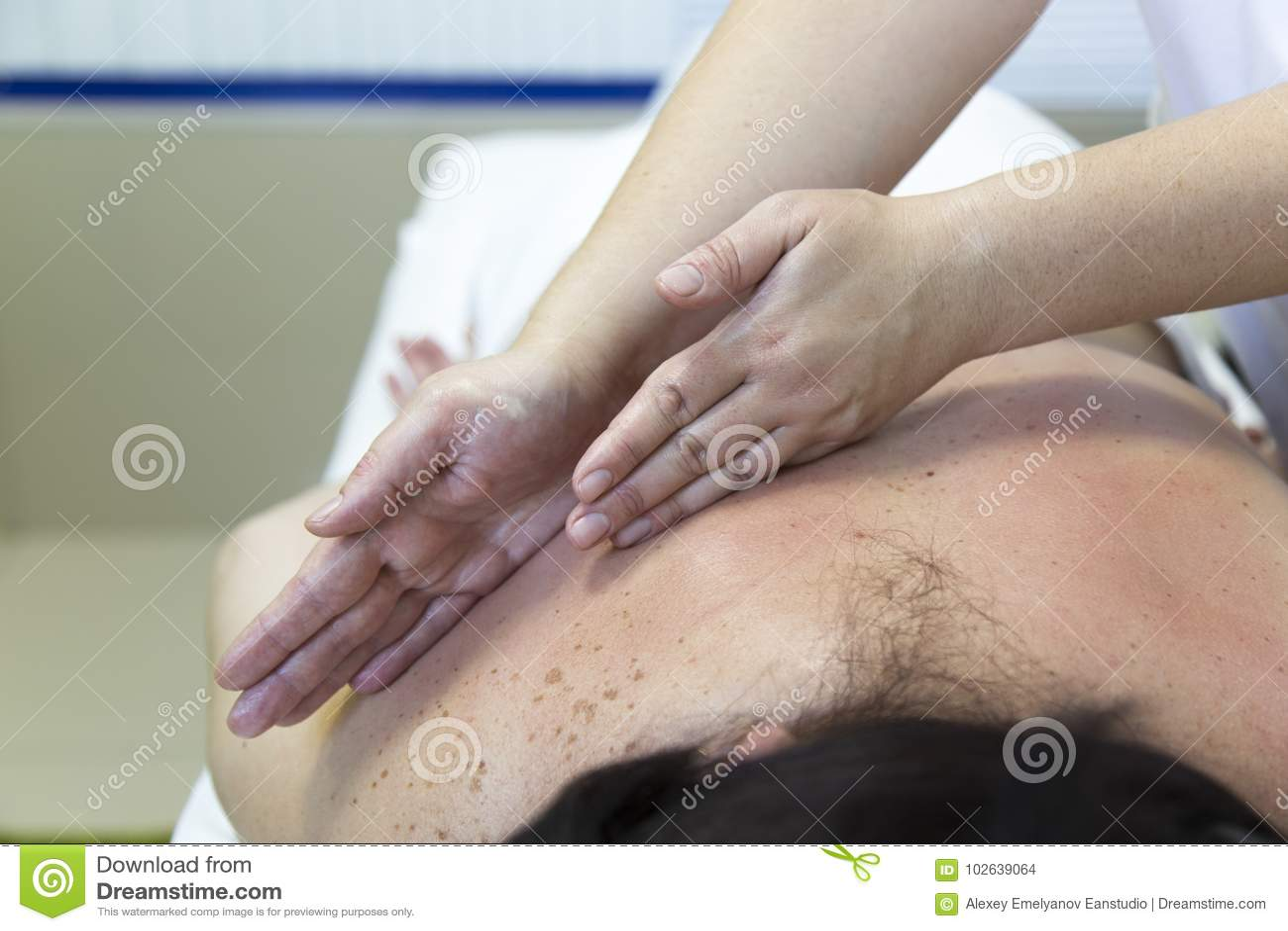 Massage women`s shoulders and waist.