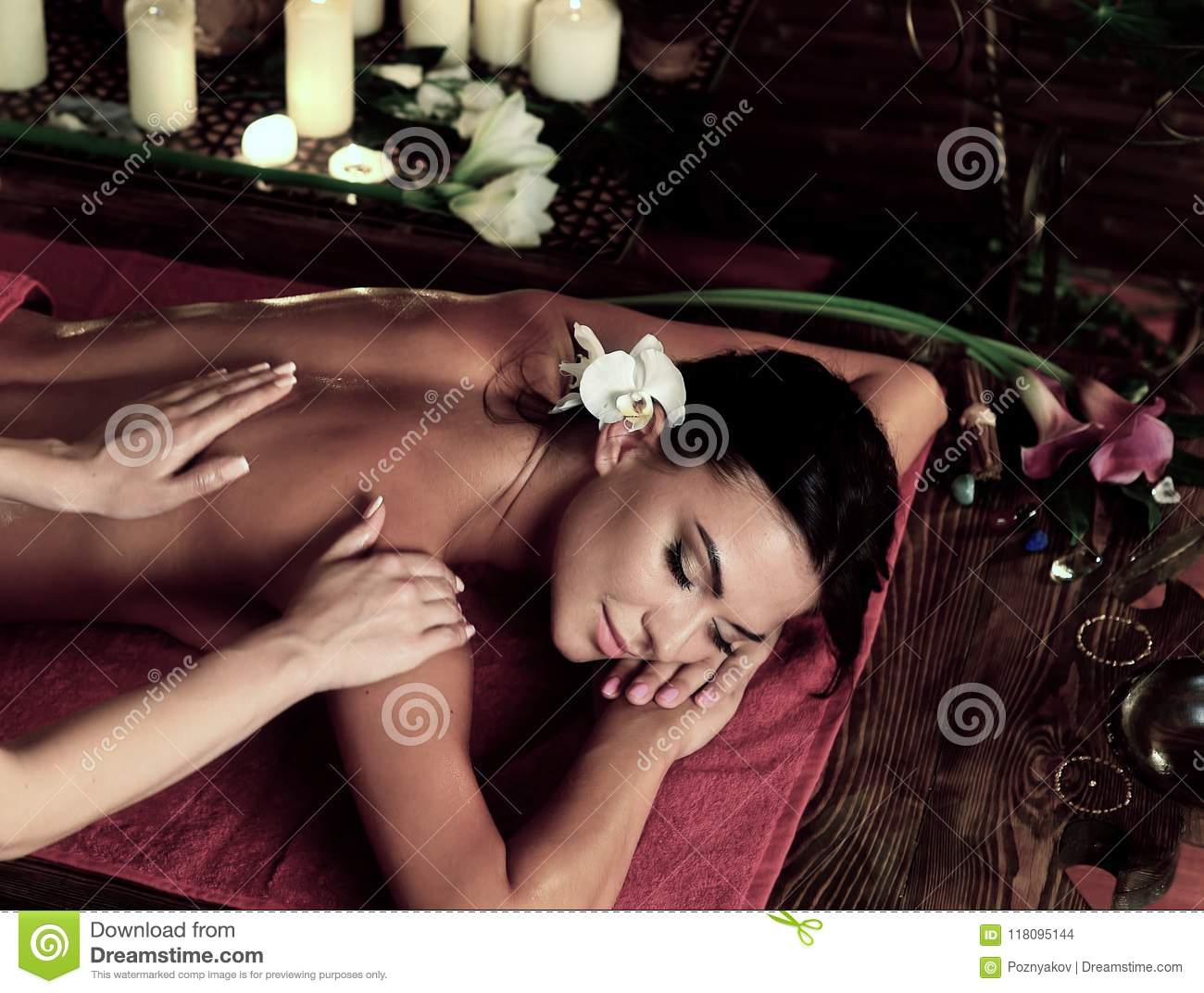 Massage of woman in spa salon. Luxary interior oriental therapy.