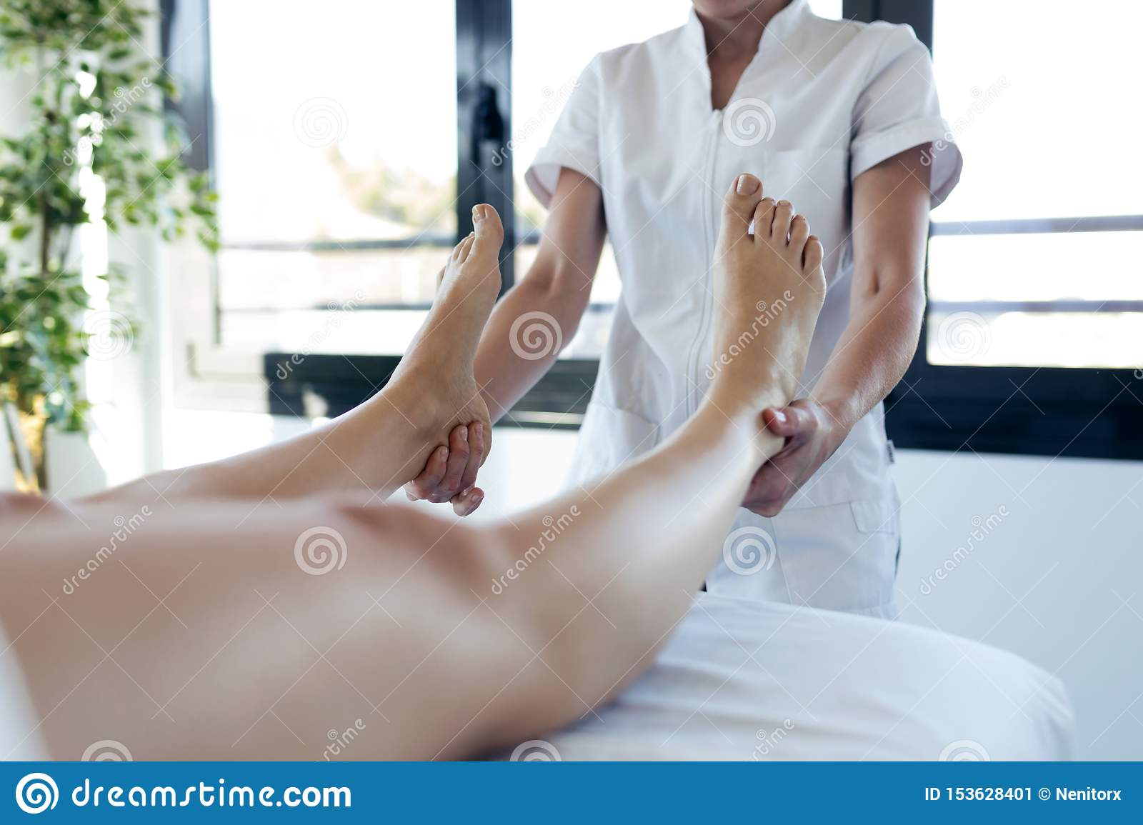 Masseur Massaging The Pregnant Woman`s Legs In Spa Center ...