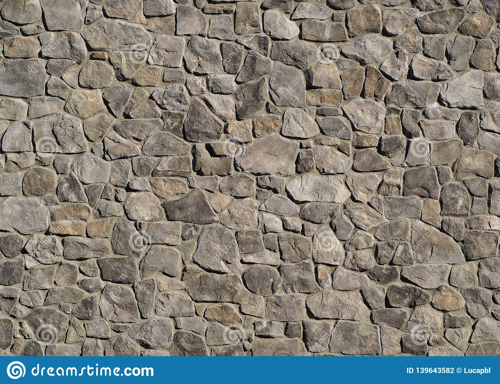 Massive Exterior Wall Cladding Made Of Gray Natural Stones