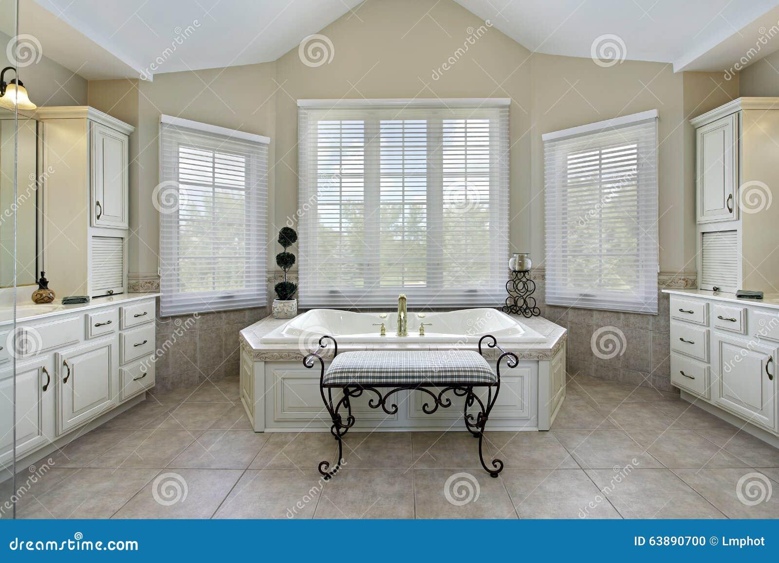 Master Bath With Large Bathtub Stock Photo - Image of decorate ...