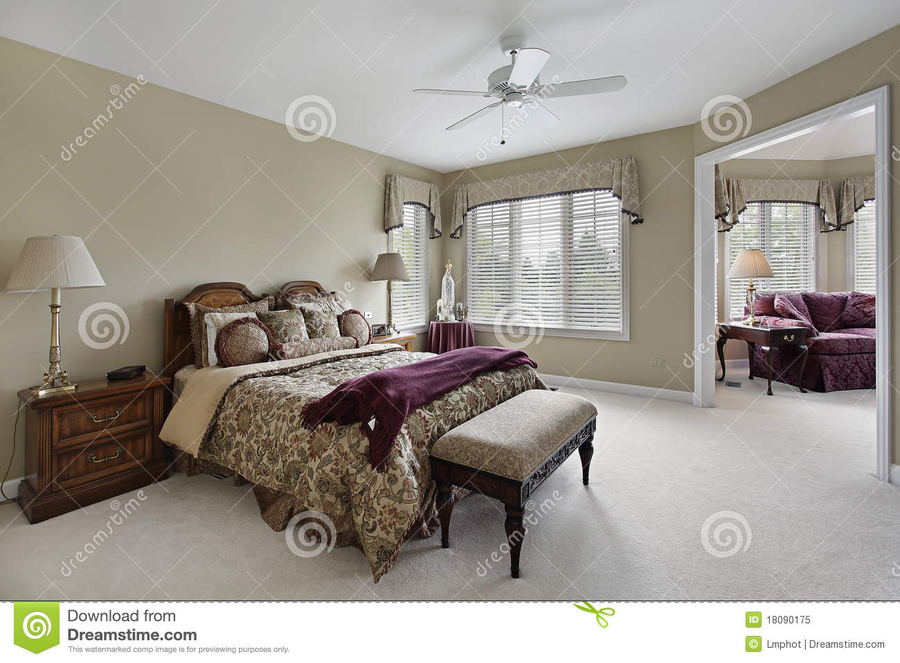 Master bedroom with adjacent sitting room royalty free stock photo
