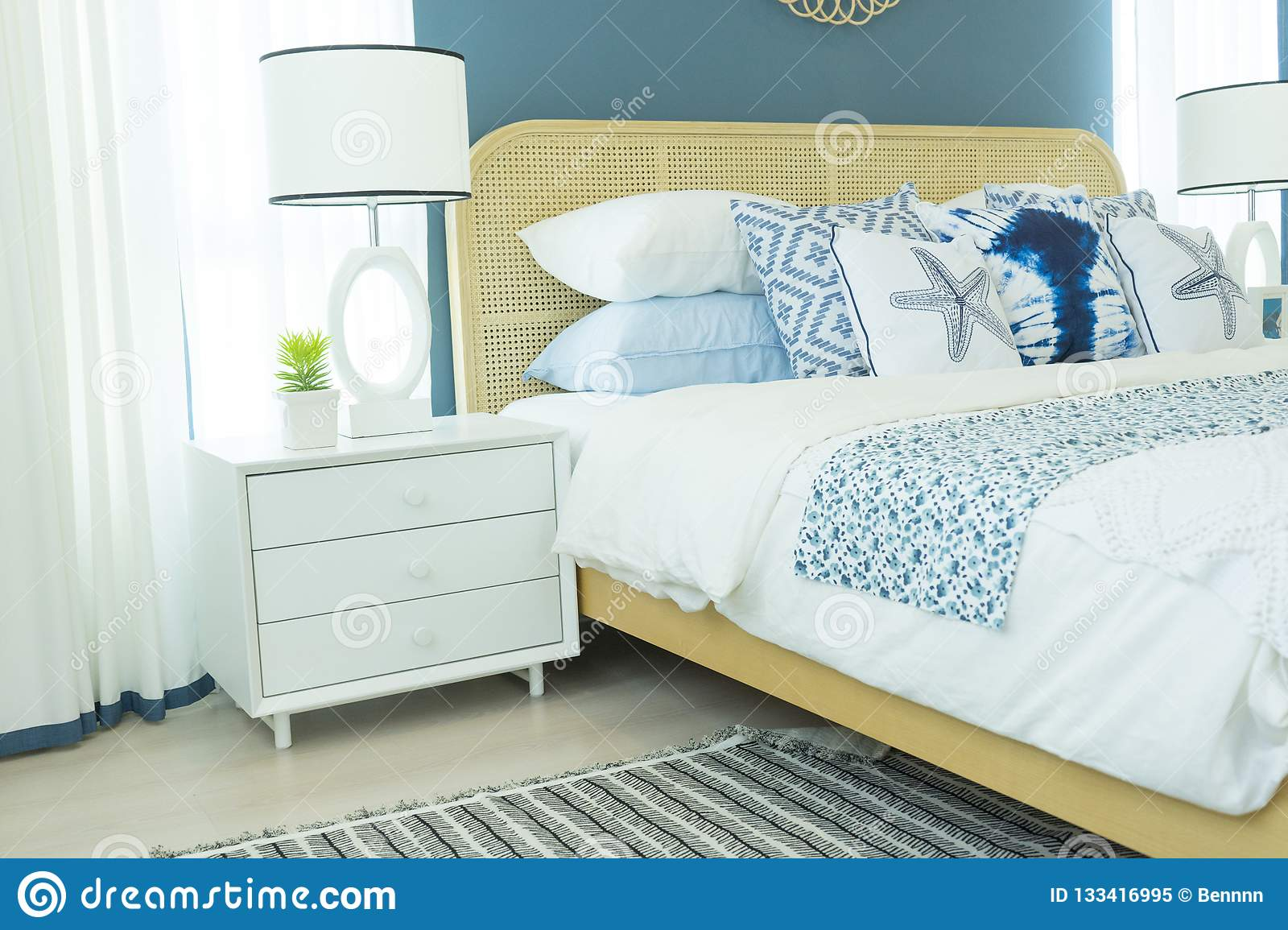 Picture of: Master Bedroom With Blue Wall And White Table Lamp Stock Image Image Of Interior Home 133416995