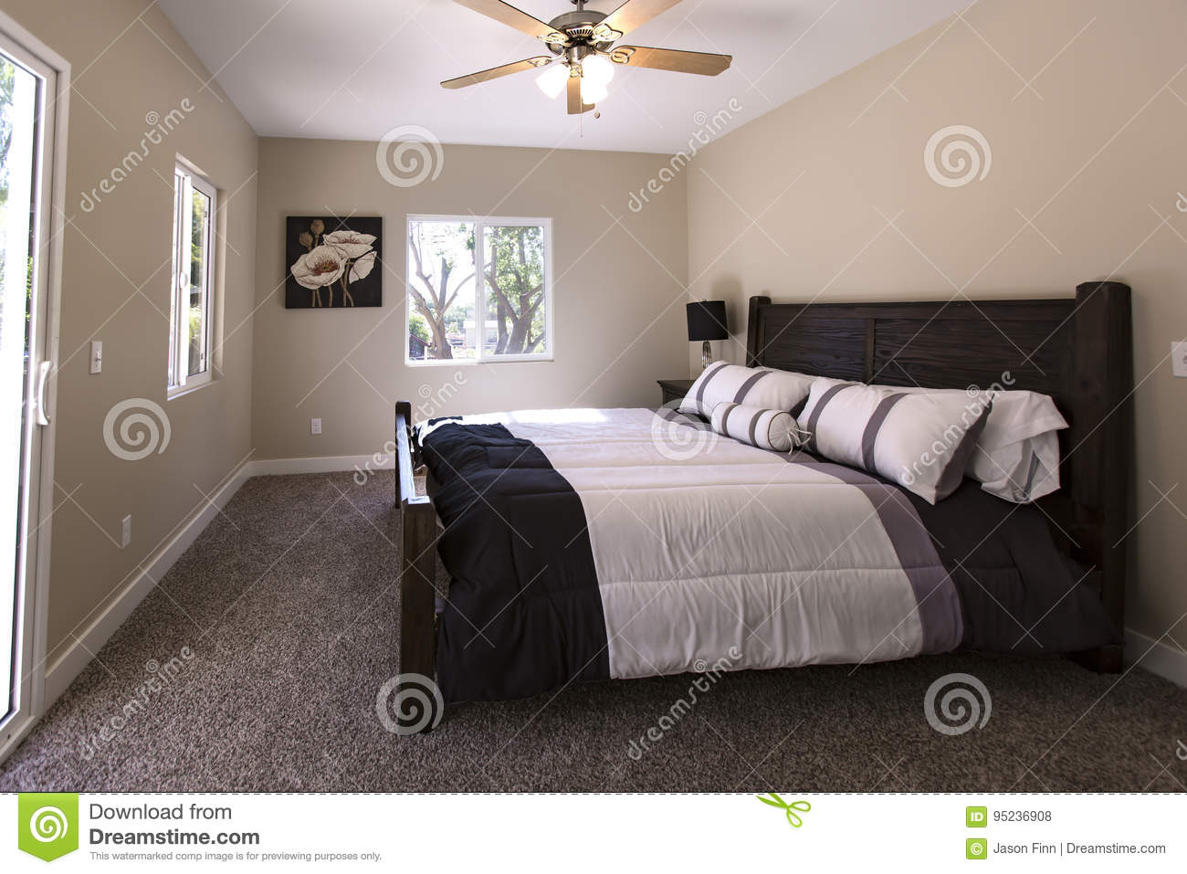 Master Bedroom With Dark Carpet And Bed Made San Diego
