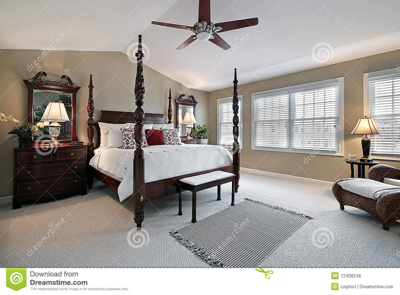 Master bedroom with dark wood furniture royalty free stock for Master bed furniture