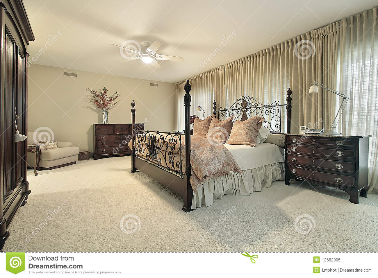 royalty free stock photo master bedroom with dark wood furniture
