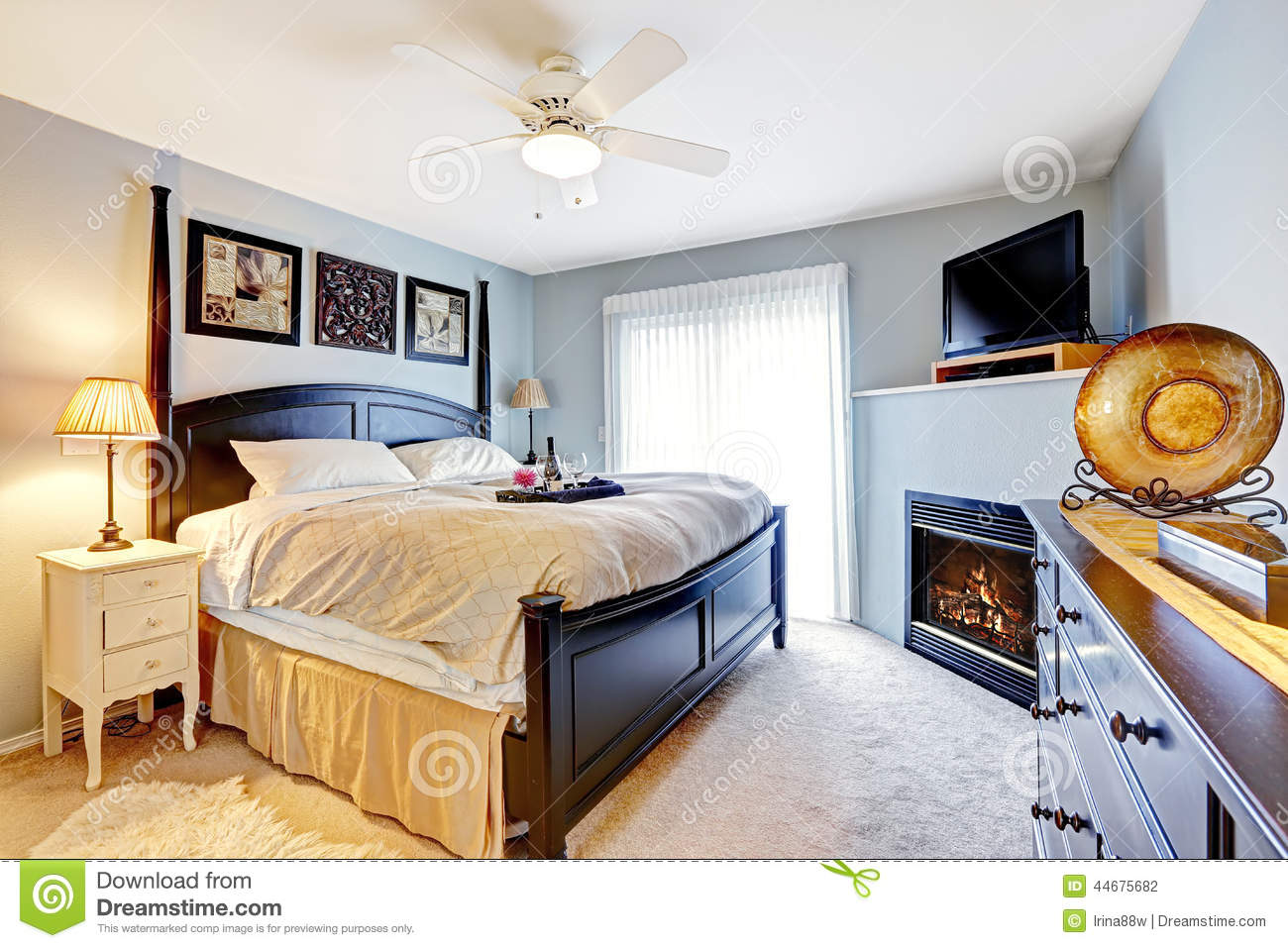 master bedroom with fireplace and tv stock photo image of home interior 44675682. Black Bedroom Furniture Sets. Home Design Ideas