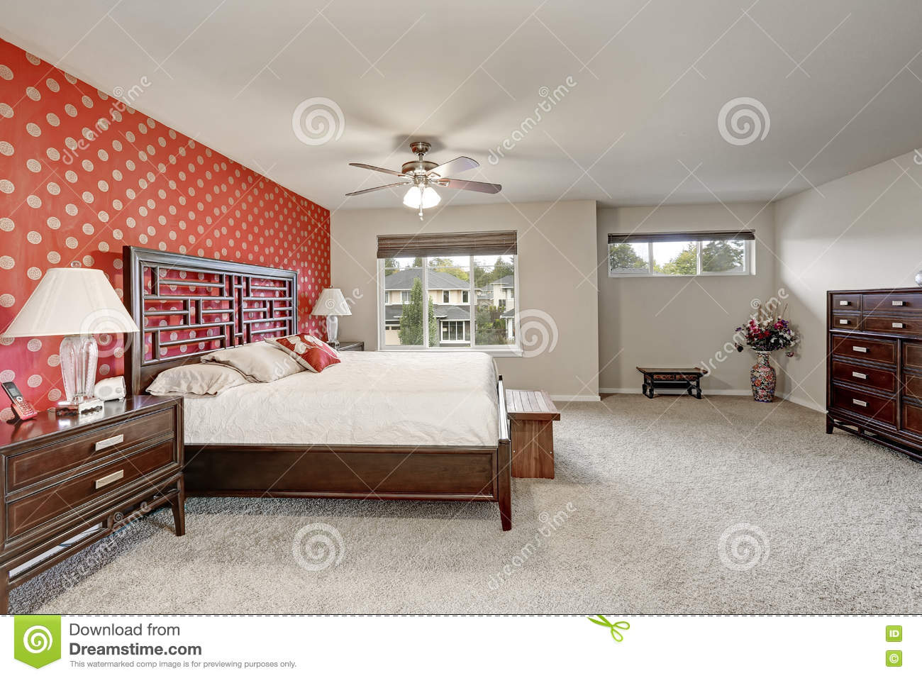 Master Bedroom Interior With Large Bed And Red Wall Stock Photo