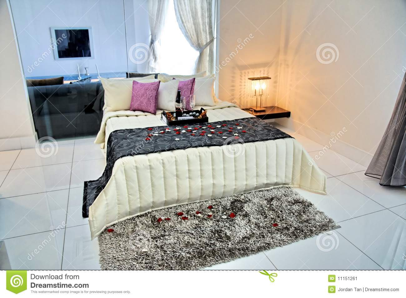 Master bedroom in a luxury condominium stock image image for Well decorated bedroom
