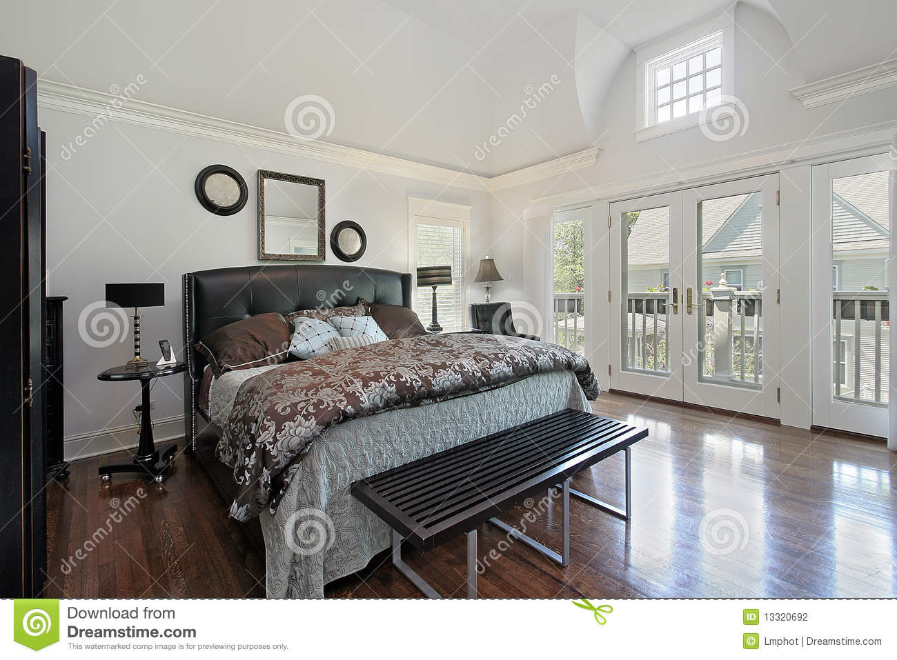 Master bedroom in luxury home with balcony stock photo for Home bedroom image