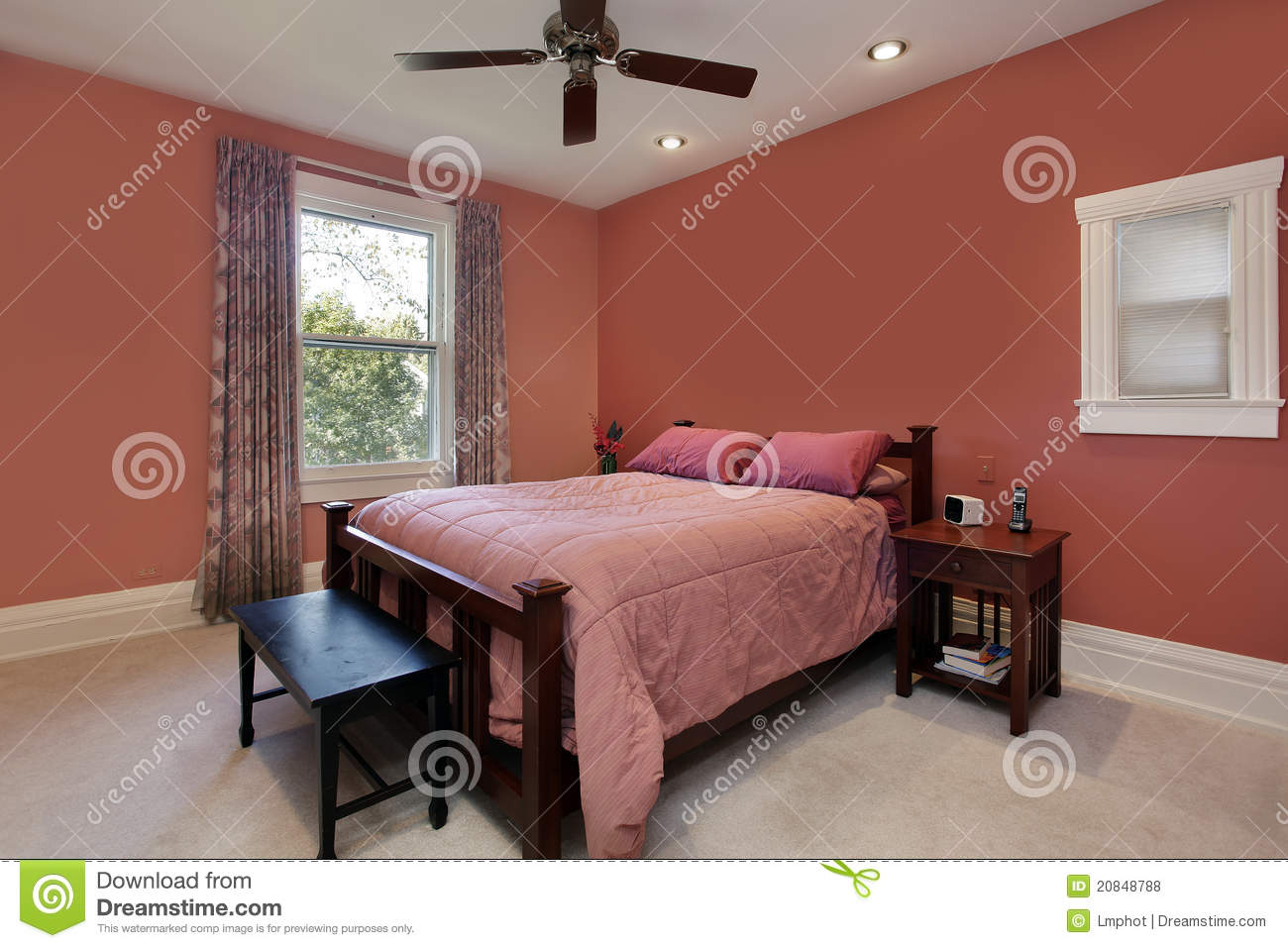 master bedroom with peach colored walls royalty free stock photos