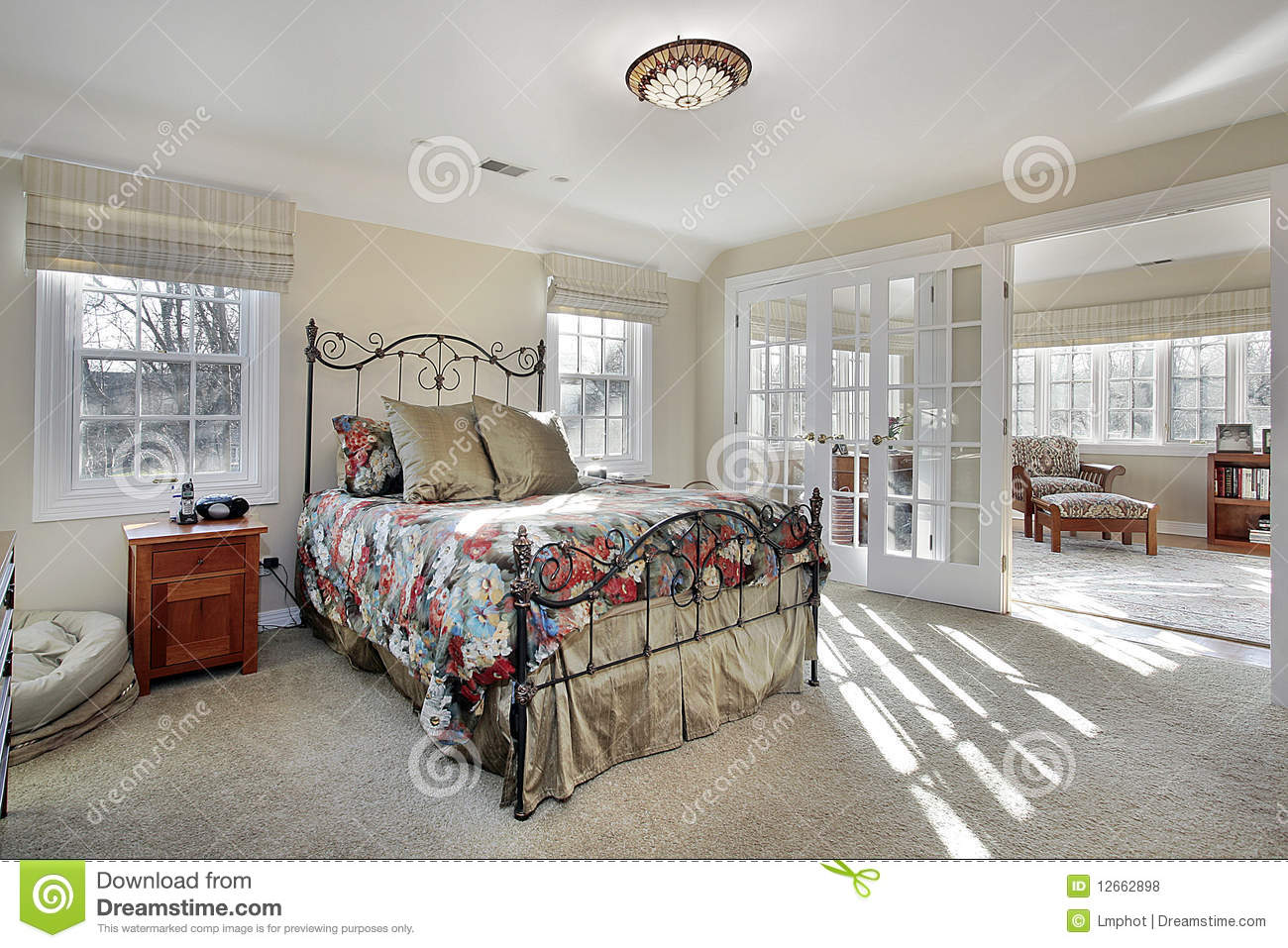 Master bedroom with sitting room and wall of windows