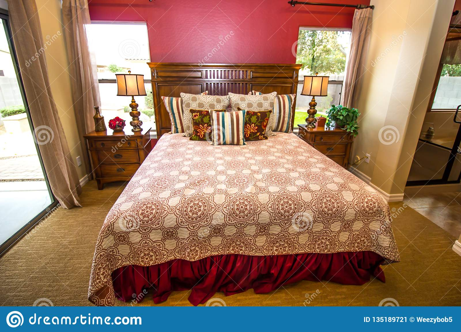 Master Bedroom With Wooden Nightstands And Lamps Stock Image Image Of Deorator Tree 135189721