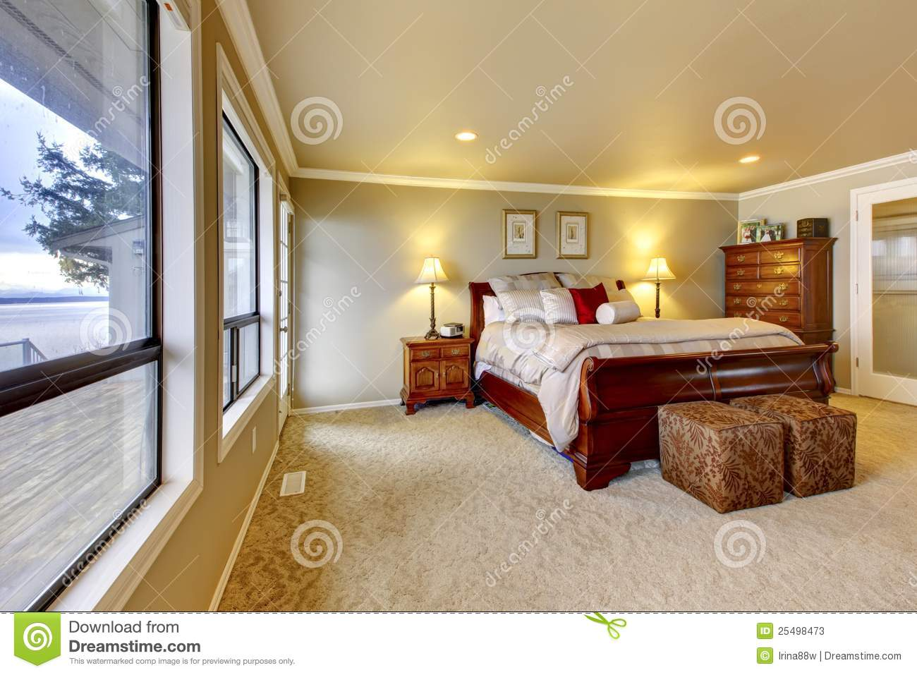 Master Bedroom Wtih Beige Walls And Wood Bed Stock Image Image 25498473
