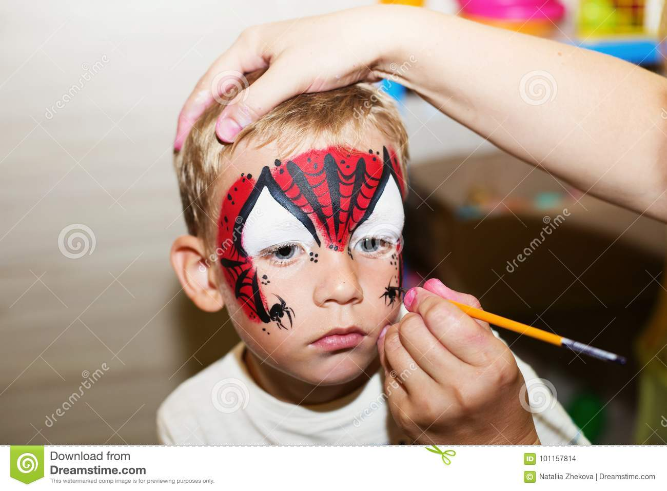 Halloween Makeup For Kids Boy.Master Making Aqua Makeup On Boys Face Stock Photo Image