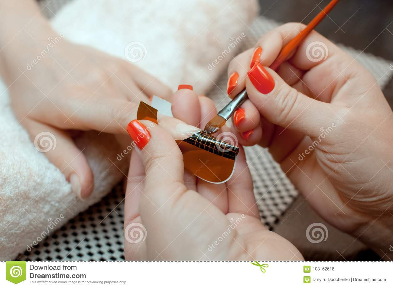 The Master Of The Nail Polish Puts A Fixative On The Finger Before ...
