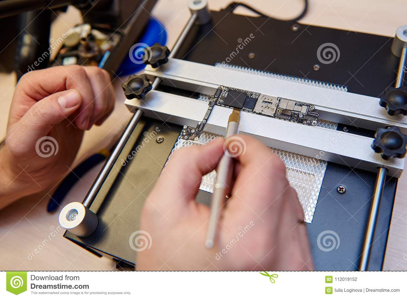 The Masters Hands Repairing An Electric Board Of Mobile Phone Buy Circuit Boardmobile