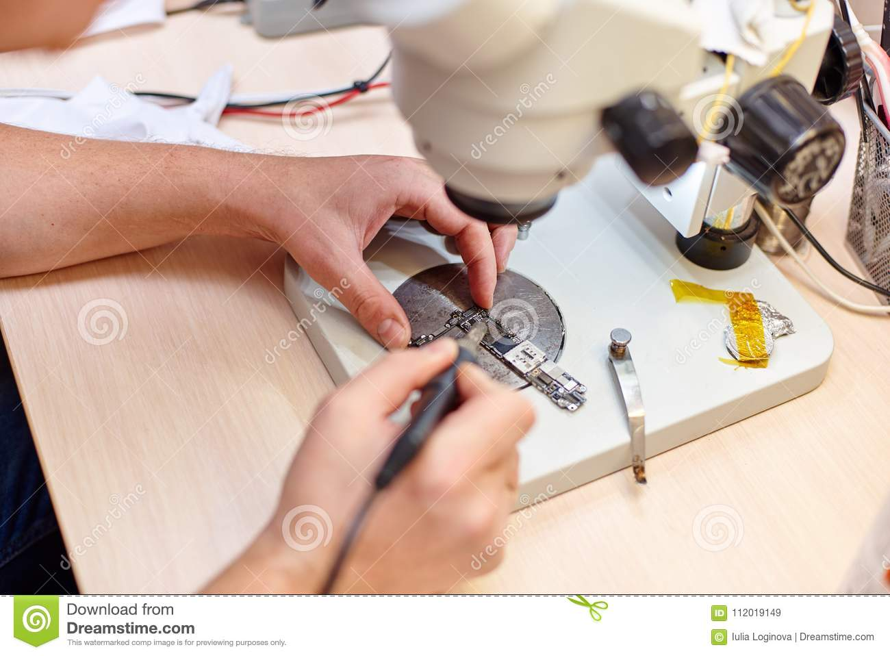 The Masters Hands Soldering An Electric Board Of Mobile Phone Buy Circuit Boardmobile With Microscope