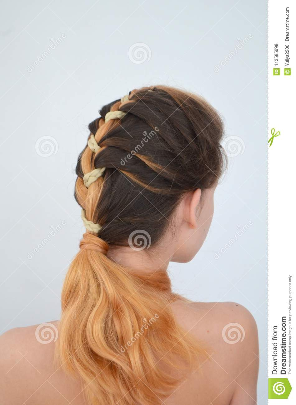 Mastery Of Weaving From Hair With Long Length Of Hair Stock Photo