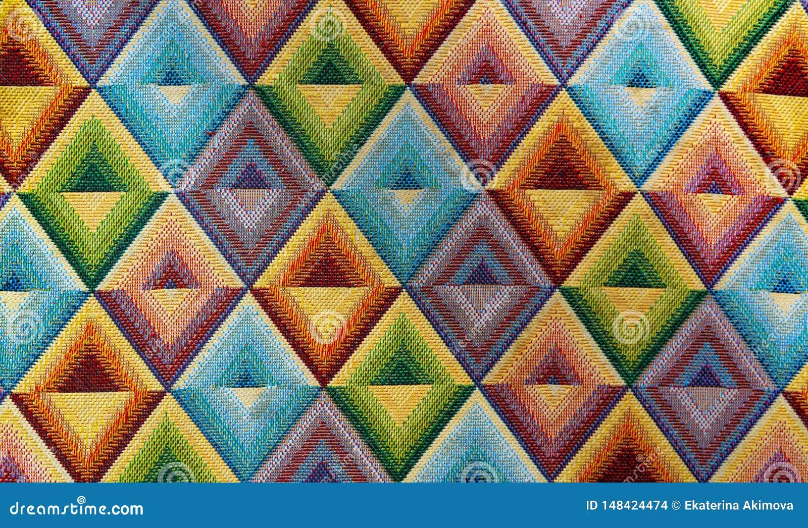 A matéria têxtil da tela com rombo brilhante dos testes padrões multi-coloriu o fundo