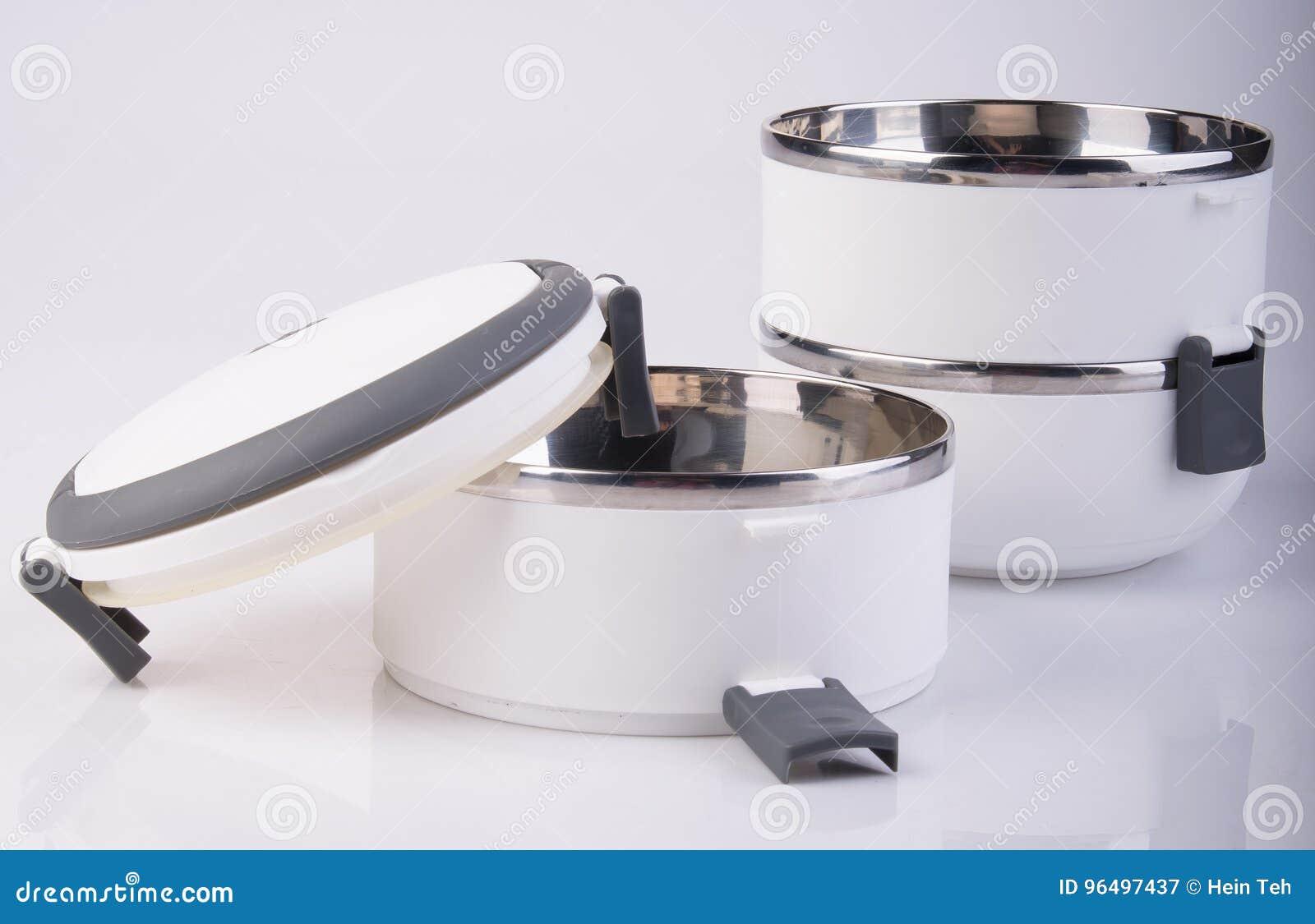 Matbehållare Tiffin eller matbärare på bakgrund