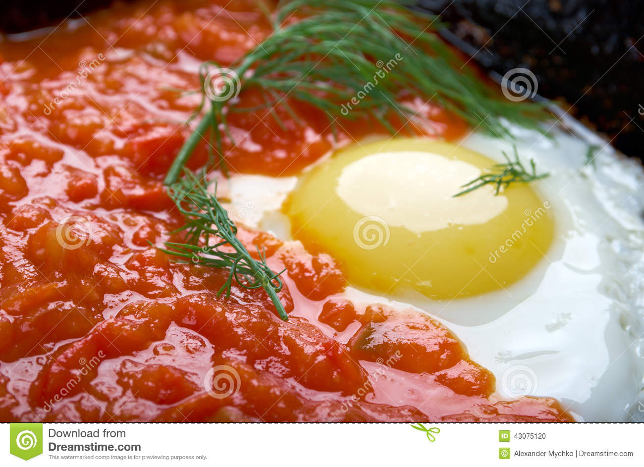 Matbucha and scrambled eggs cooked dish of tomatoes and roasted bell ...