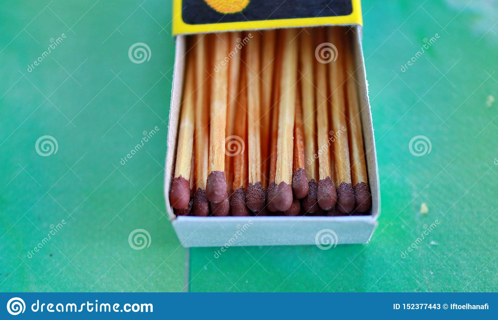 Matches in box, green background.