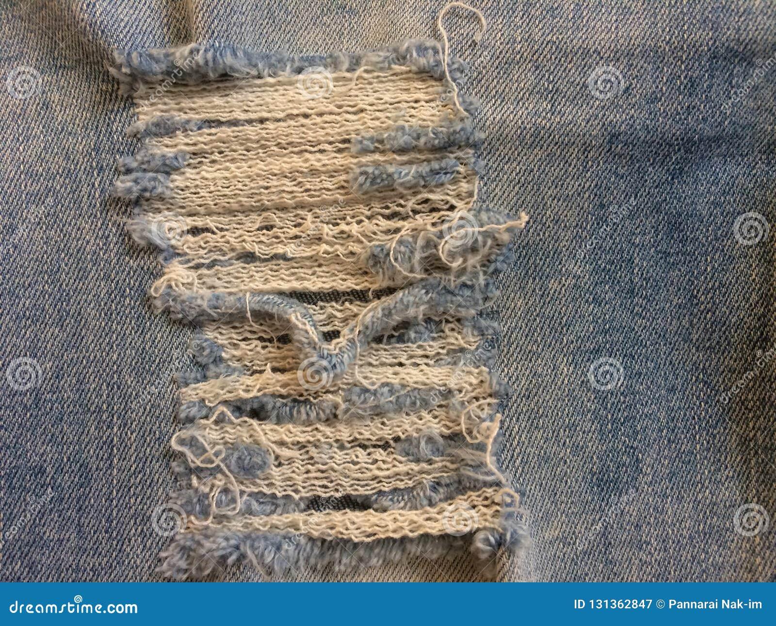 Materia textil de tejanos, la piel facial del dril de algodón