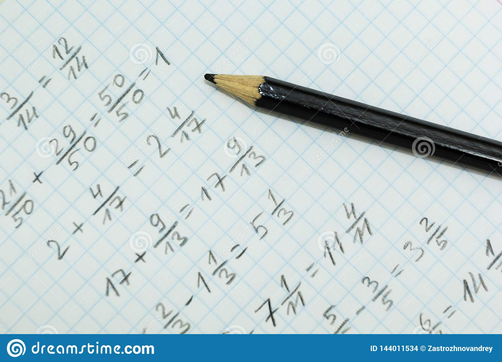 Math problems on graph paper with black pencil