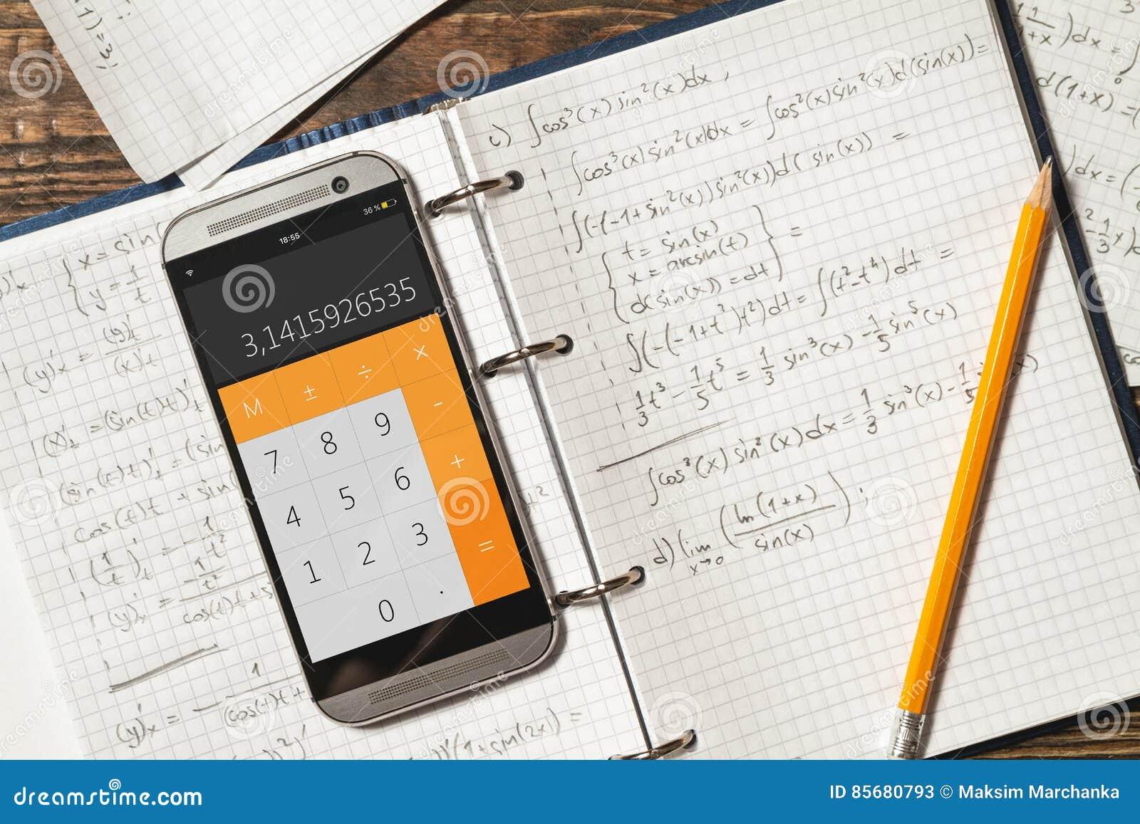 Mathematical Equations Written In A Notebook Calculator App Stock