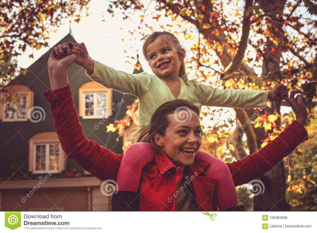 Mather with daughter enjoy in autumn season.