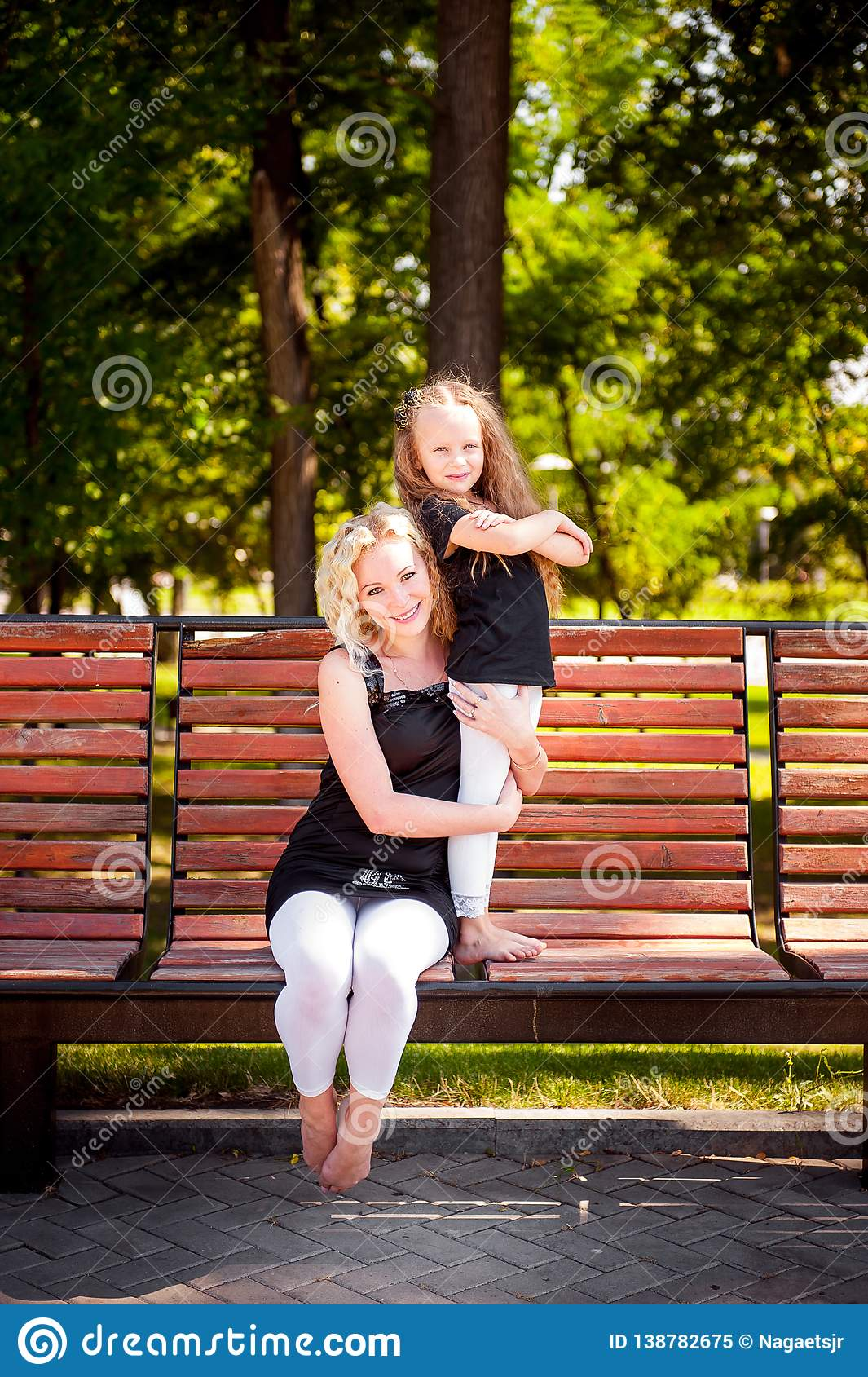 Mather and her daughter in the park.