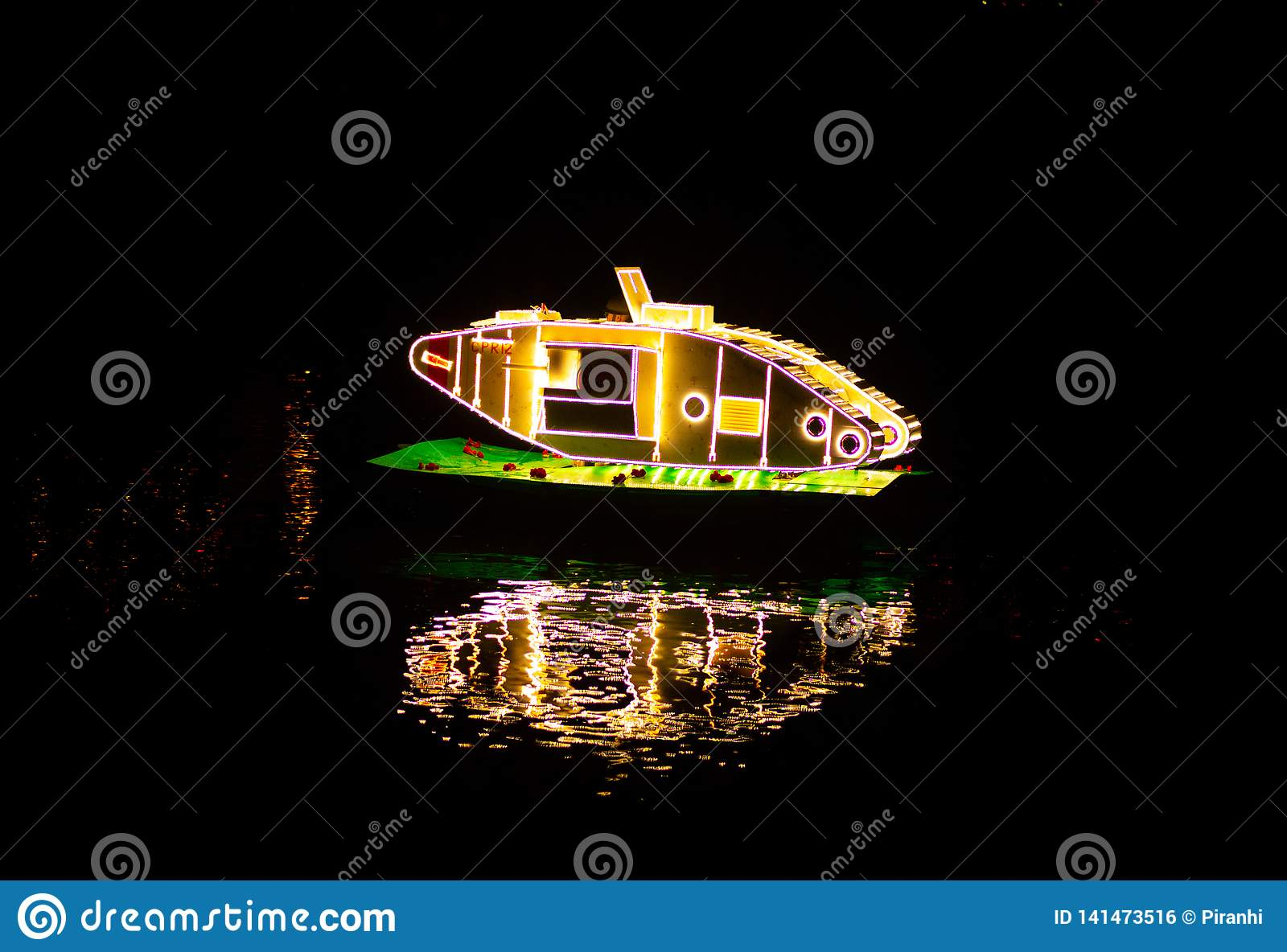 MATLOCK BATH, ENGLAND - OCTOBER 6TH, 2018: A bright tank floating on the river for the Matlock bath Illumination