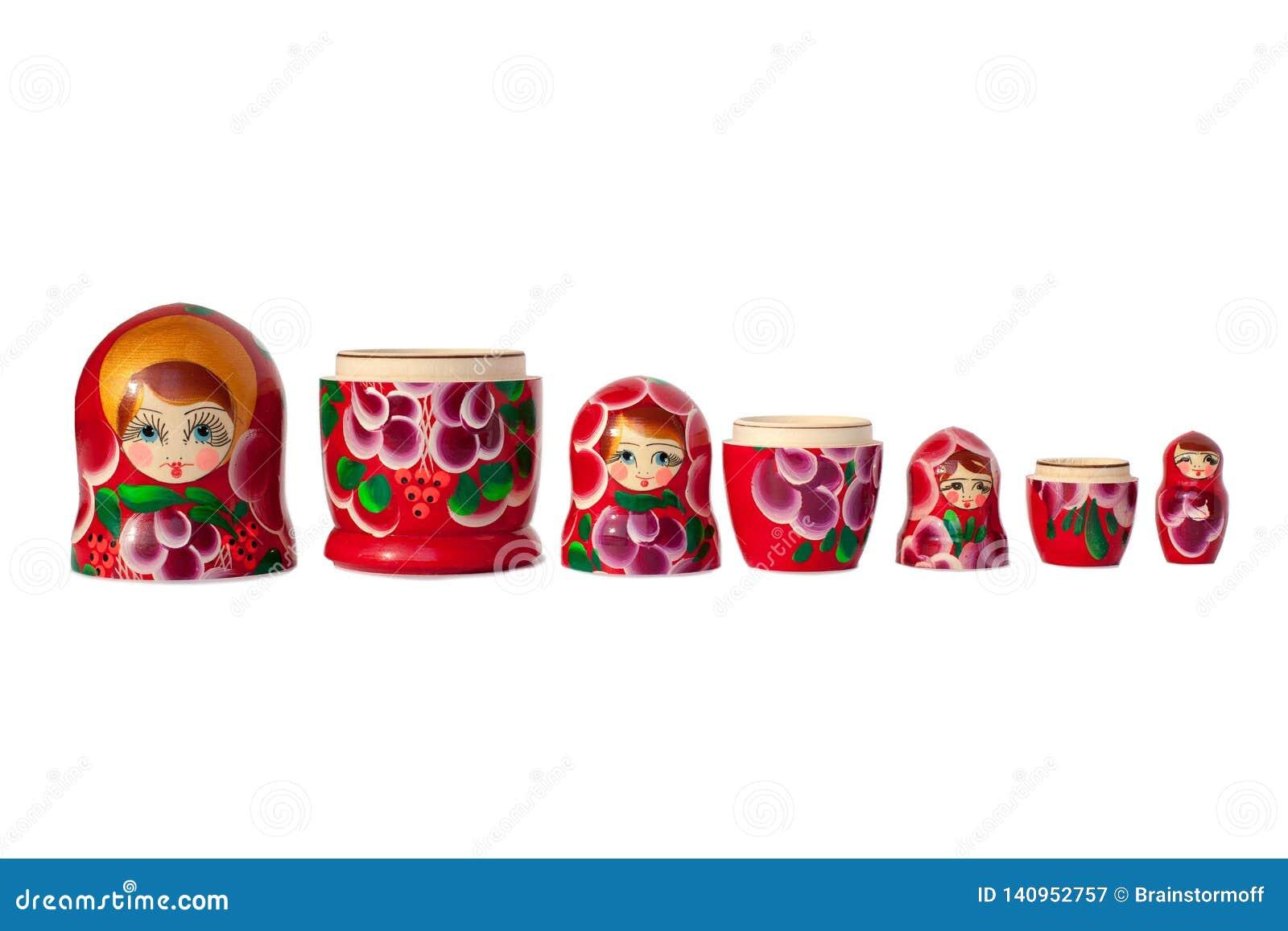 Matreshka ρωσικό κουκλών σχέδιο λουλουδιών αναμνηστικών φωτεινό κόκκινο, πορφυρό και πράσινο στην άσπρη απομονωμένη υπόβαθρο κινη