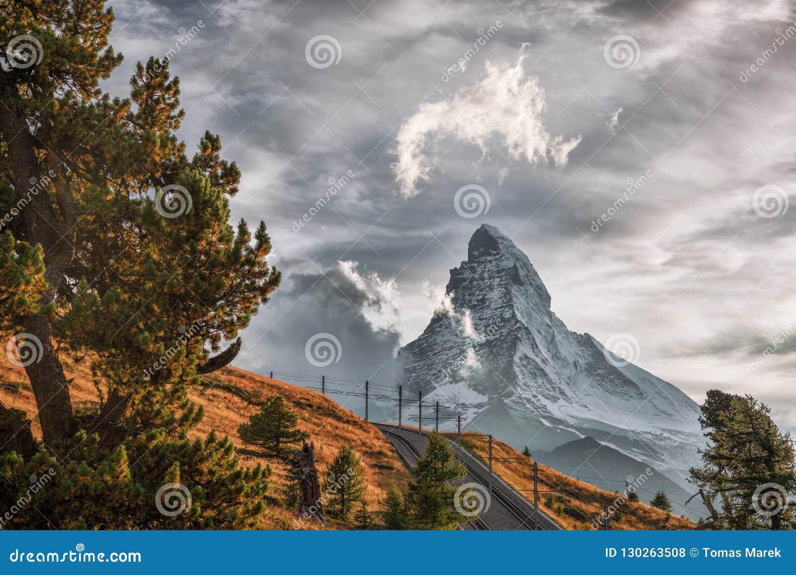 Matterhorn peak with railway with sunset in Swiss Alps, Switzerland