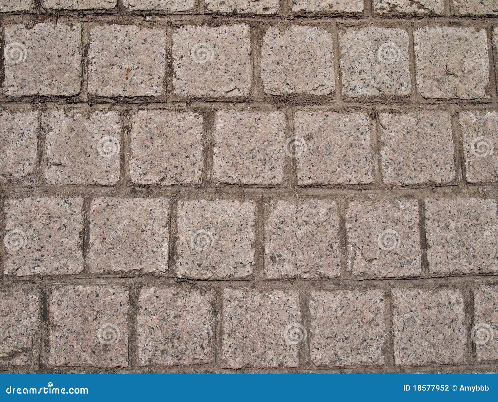 mattoni di pietra a forma di quadrati colorati grigi