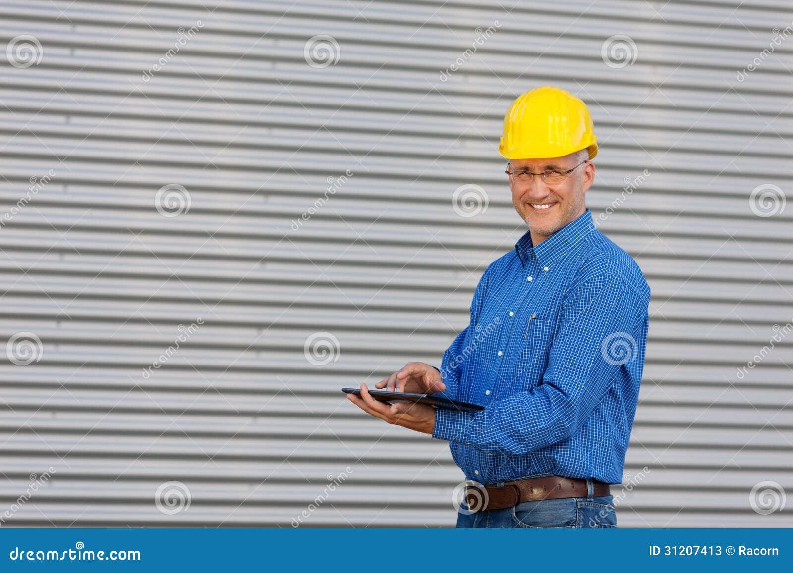 Mature Architect Using Digital Tablet