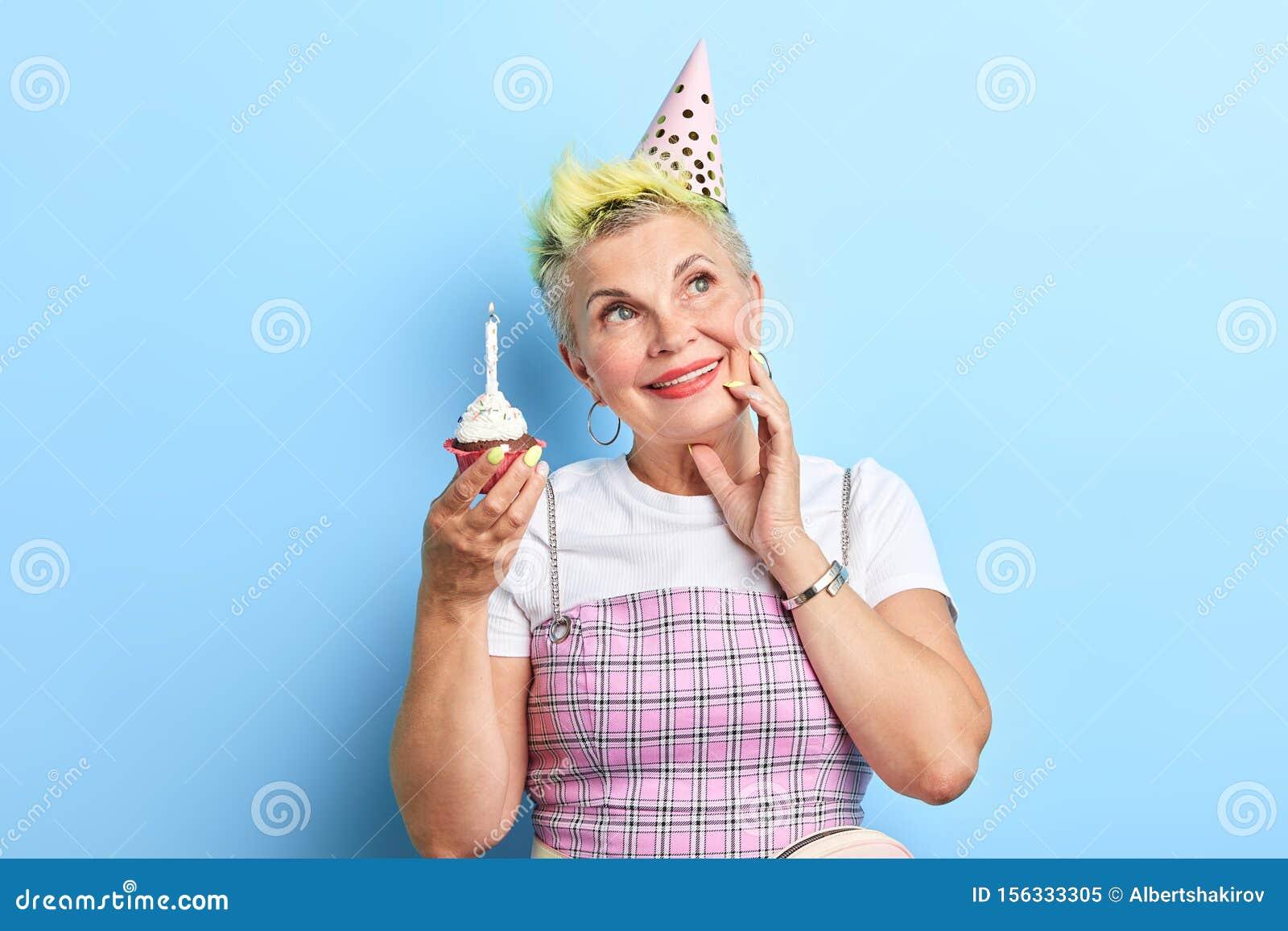 Stupendous Mature Beautiful Woman Holding A Birthday Cake Touching Her Cheek Funny Birthday Cards Online Elaedamsfinfo