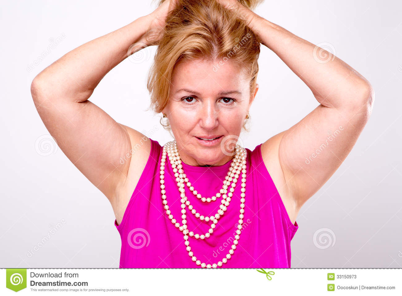 Mature Blonde Lady With Both Arms Up Stock Photos - Image 33150973-6761